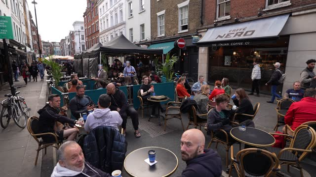 diners gather outside in old compton street, soho as restaurants cater for outdoor dinning as lockdown restricting ease on april 27, 2021 in london,... - dining stock videos & royalty-free footage