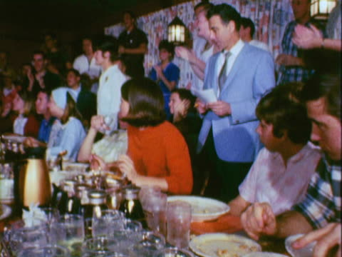 montage diners in a restaurant competing in a pancake eating contest and winners posing with trophies / california, united states - batter food stock videos & royalty-free footage