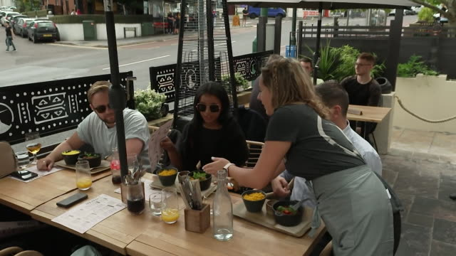 diners in zim braai restaurant in bournemouth eating out on the last day of the government's eat out to help out scheme to get people back out after... - bournemouth stock-videos und b-roll-filmmaterial