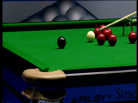 ding junhui makes tough pot on black using spider rest as he continues his 147 break against anthony hamilton the masters wild card round wembley... - pool cue sport stock videos & royalty-free footage