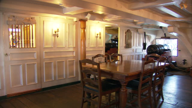 ws pan dining room in captain's quarter on a level of uss constitution first launched in 1797 ('old ironside') / boston, massachusetts, usa - uss constitution stock videos and b-roll footage