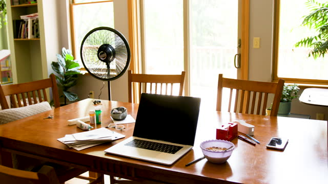 dining room table turned into casual home office in light filled room - dining room stock videos & royalty-free footage