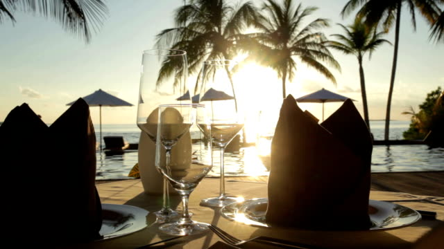 dining table at sunset - maldives stock videos & royalty-free footage