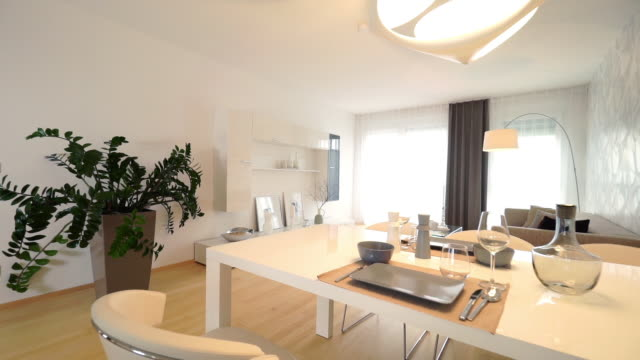 dining table in living room - wohnzimmer stock-videos und b-roll-filmmaterial