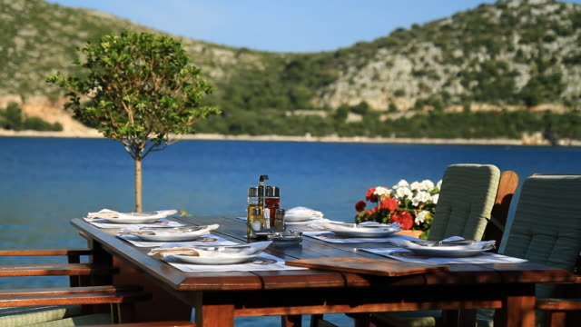 hd: dining table on mediterranean coast - mediterranean culture stock videos & royalty-free footage