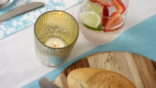 dining table - summer lunch - high angle - tea light stock videos and b-roll footage