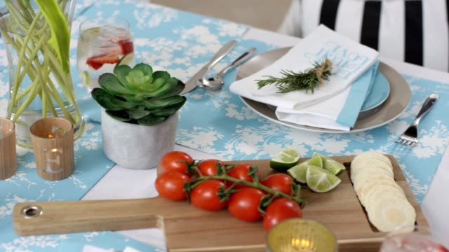 dining table - summer lunch table setting - tea light stock videos and b-roll footage