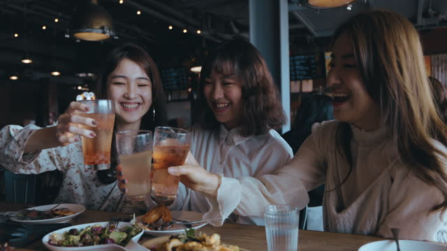 dining with friends at the restaurant - east asian ethnicity stock videos & royalty-free footage