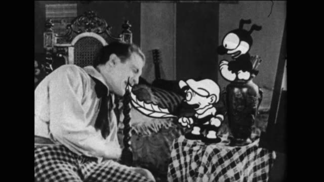 dinky doodle and his dog wake the artist up from his dream - fare il solletico video stock e b–roll