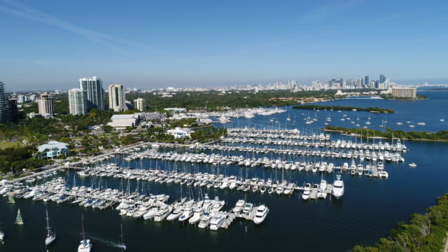dinner key marina 4k aerial with downtown miami in the distance - grove stock videos & royalty-free footage