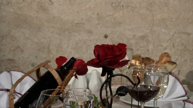 Dinner Table with a Red Rose