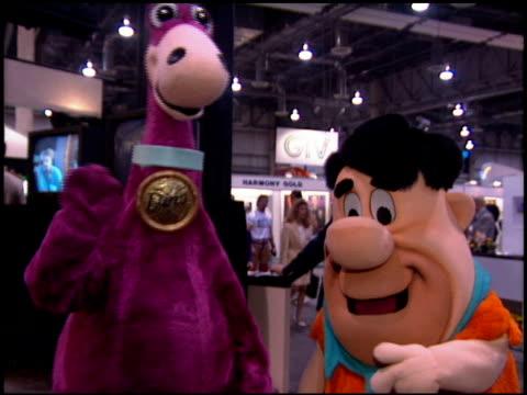 vídeos de stock e filmes b-roll de dino at the natpe convention on january 25, 1995. - natpe convention
