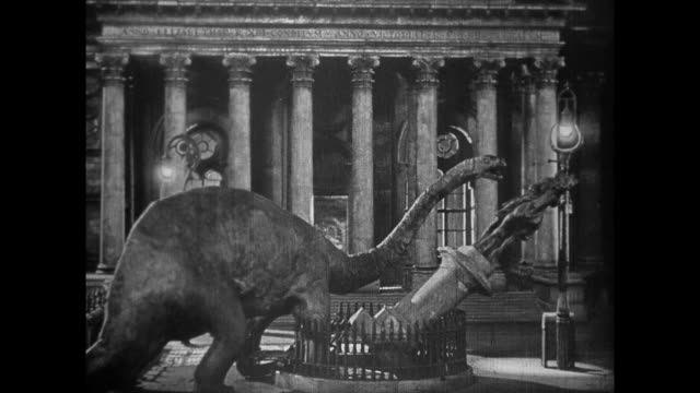 1925 dinosaur loose in downtown london terrifies fleeing crowds and breaks statue - double decker bus stock videos & royalty-free footage