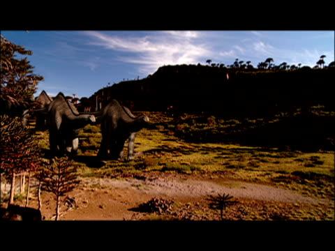 cgi, dinosaurs walking slowly in landscape  - eoraptor stock videos and b-roll footage