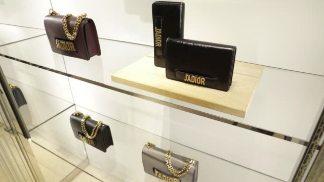 A Dioevolution flap bag sits on display at a Christian Dior SE store in Shanghai China on Saturday June 10 Close up DiorAddict wallets sit on display...