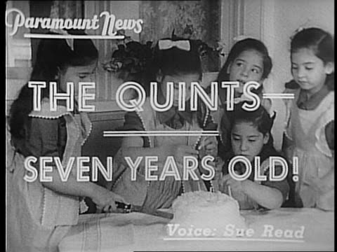 Dionne quintuplets dressed up / exterior of house Red Cross truck pulling up / woman and quints walk out girls wear their Brownie uniforms / note...