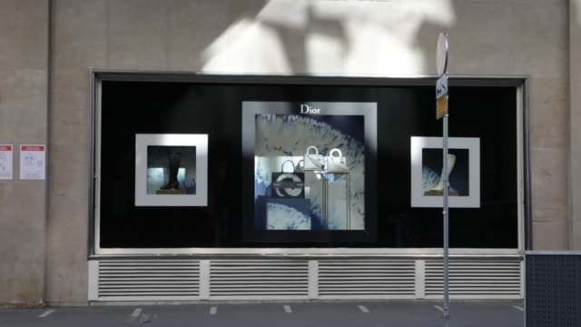 dior store windows at le bon marché paris france as lvhm reported earnings on tuesday july 28 2020 - silver coloured stock videos & royalty-free footage