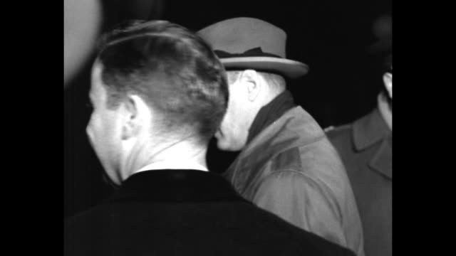 vs us diplomat george kennan is greeted at nighttime berlin airport he enters large sedan and drives off - westberlin stock-videos und b-roll-filmmaterial