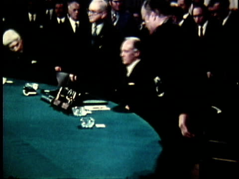 diplomats and officials sitting down at the negotiating table during the pars peace accord deliberations / paris france - 1973 stock videos & royalty-free footage