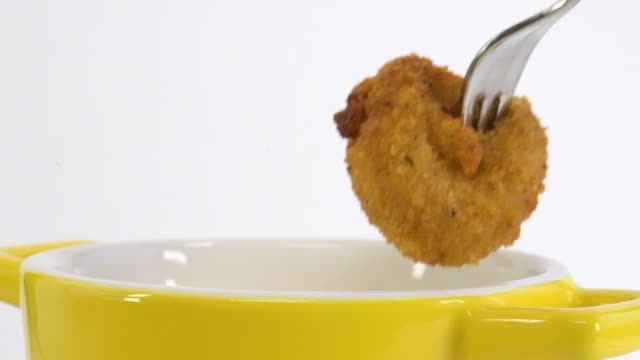 dipping a chicken nugget in sauce, slow motion - salty snack stock videos & royalty-free footage
