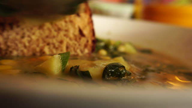 dipping bread into soup potato supper sweet corns close-up - potato soup stock videos & royalty-free footage