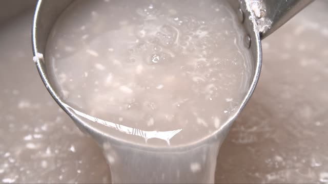 dipping out sikhye(sweet rice drink) with a ladle - ladle stock videos & royalty-free footage