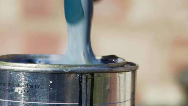 Dipping Paintbrush in a Varnish Tin