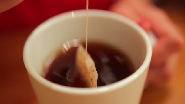 dipping tea bag - mug stock videos & royalty-free footage