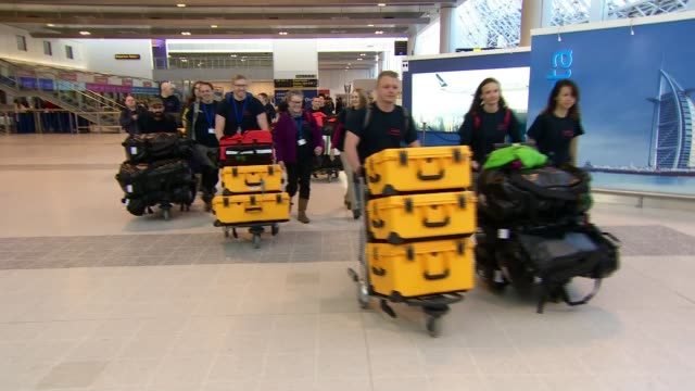 Diptheria outbreak amongst Rohingya refugees ENGLAND Manchester Manchester Airport INT Various of doctors nurses and firefighters wheeling medical...