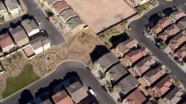 hd aerial *direct td ws neighborhood at west edge of clark county moving over tightly packed planned community houses w/ newer asphalt blacktop roads... - 2008 stock videos & royalty-free footage