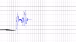 direct top view of polygraph lie detector test needle drawing a red line on graph paper