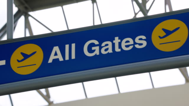 ms pan directional sign of all gates at lax - lax airport stock videos & royalty-free footage