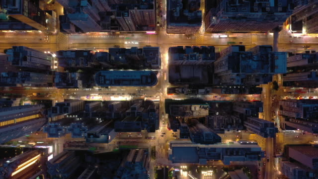 directly above aerial of city street in night real time - major road video stock e b–roll