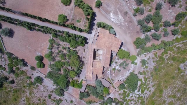 directly above aerial view of hermitage of ermita de betlem in the mountains of artà ( serra artana or massís d'artà ) of balearic islands majorca / spain - pellegrinaggio video stock e b–roll