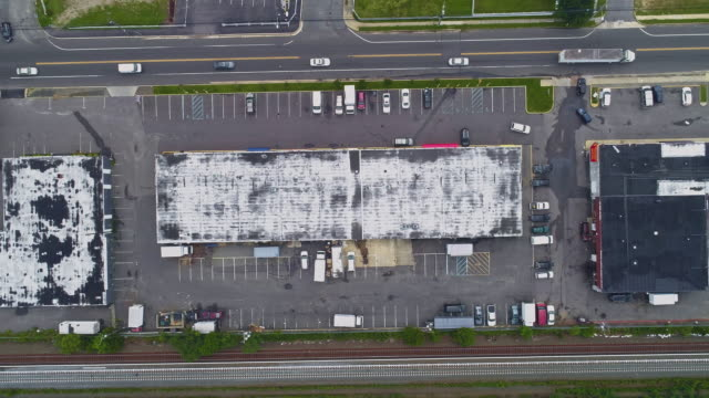 directly above, looking-down top view of the industrial zone with self-storage hangars in long island, new york state, usa. aerial drone video with the slow panning camera motion. - self storage stock videos and b-roll footage