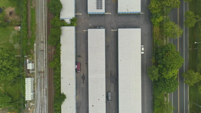 directly above, looking-down top view of the industrial zone with self-storage hangars in long island, new york state, usa. aerial drone video with the descending camera motion. - self storage stock videos and b-roll footage