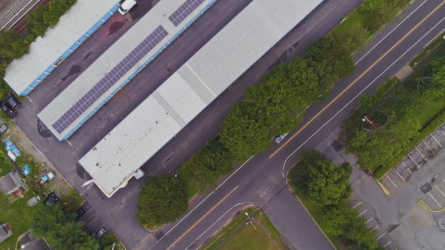 directly above, looking-down top view of the industrial zone with self-storage hangars in long island, new york state, usa. aerial drone video with the panning camera motion. - self storage stock videos and b-roll footage