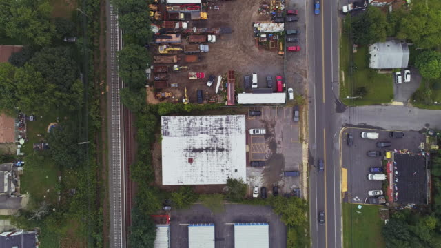 directly above, looking-down top view of the industrial zone with self-storage hangars in long island, new york state, usa. accelerated aerial drone video with the panning camera motion. - self storage stock videos and b-roll footage