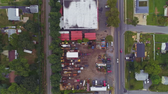 directly above, looking-down top view of the industrial zone with self-storage hangars in long island, new york state, usa. aerial drone video with the panning camera motion. - self storage video stock e b–roll