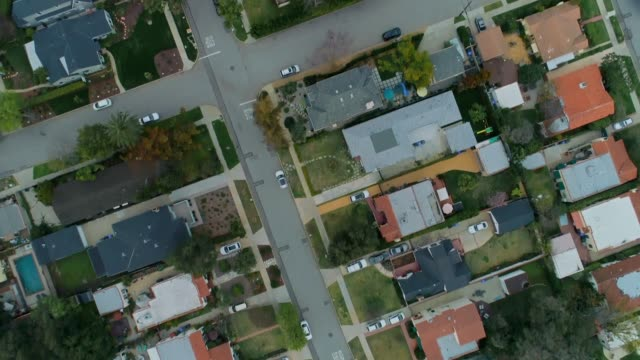 directly above middle class suburban neighborhood - housing difficulties stock videos & royalty-free footage