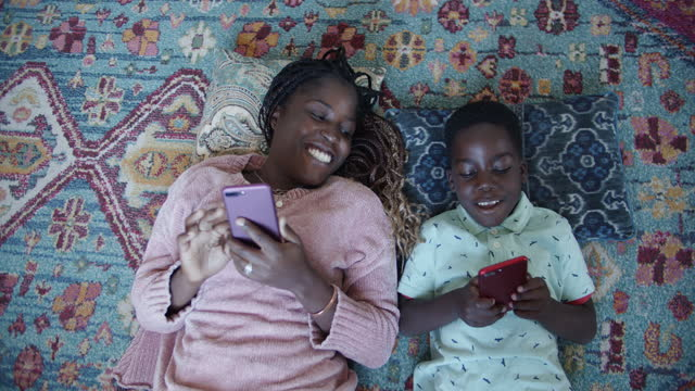 directly above, mother and son playing video games on their phone - mobile app stock videos & royalty-free footage