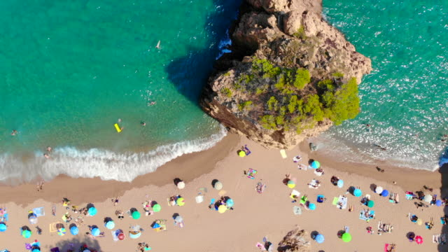 directly above of idyllic beach with people and island in the costa brava shoreline of spain. - reclining stock videos & royalty-free footage