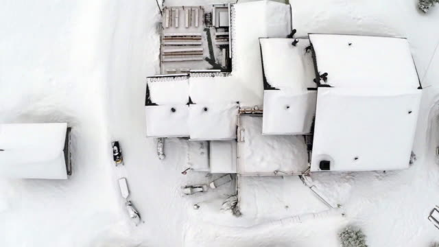 directly above shot of snow covered houses - roof stock videos & royalty-free footage
