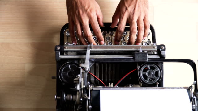 directly above view: asian's hands face the problem while using retro typewriter that is german keyboard - typewriter keyboard stock videos & royalty-free footage