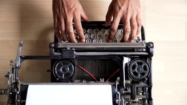 directly above view: asian's hands use retro typewriter that is german keyboard - above stock videos & royalty-free footage