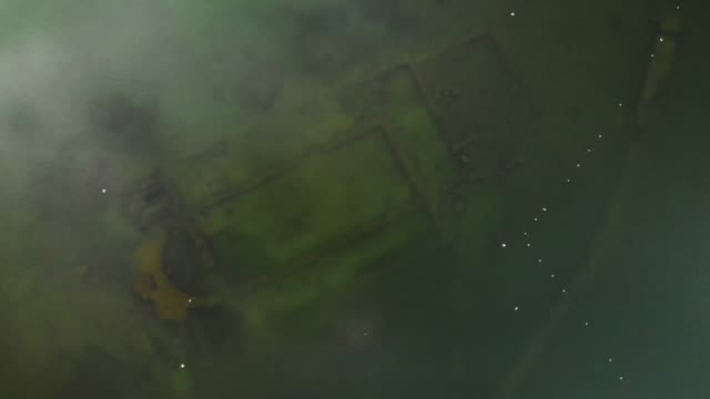 directly above view of ancient sunken basilica in iznik lake, turkey - arte dell'antichità video stock e b–roll