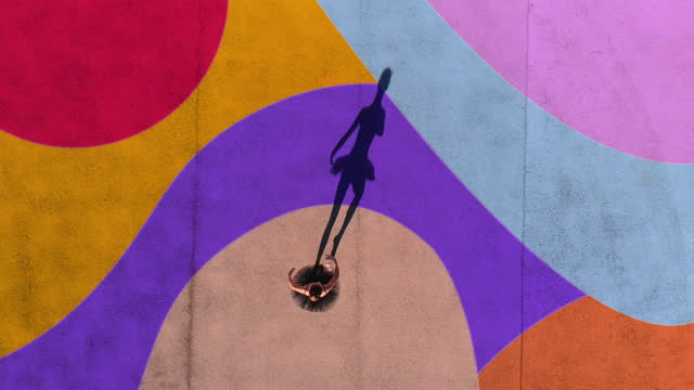 vidéos et rushes de directly above view of ballerina dancing with colorful art in the ground.. - danseur de ballet