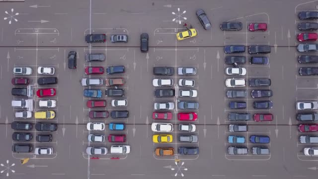 directly above view of parking lot,4k drone video - parking stock videos & royalty-free footage