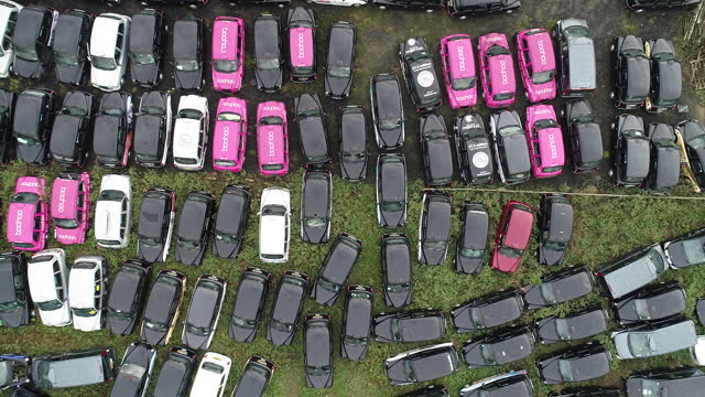directly above view of taxis stored in epping forest amid covid-19 lockdown. black cabs stored in epping forest field after coronavirus lockdown... - taxi stock videos & royalty-free footage