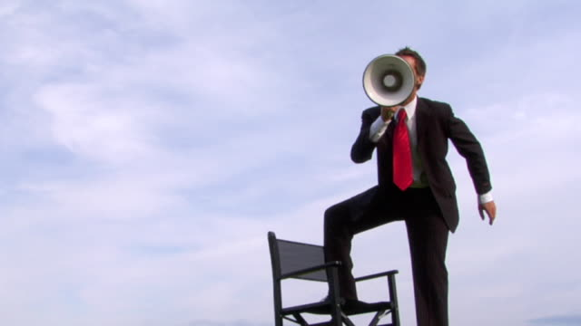 director businessman yelling at you!! - megaphone stock videos & royalty-free footage